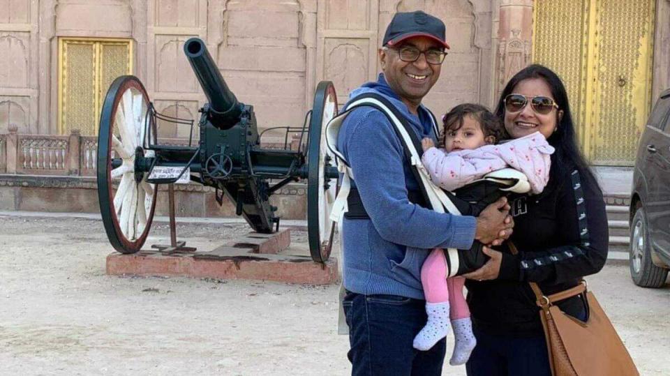 Hari Gopal Garg and Komal Garg hold baby Kaveri