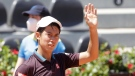 Japan's Kei Nishikori waves after winning his match against Italy's Fabio Fognini at the Italian Open tennis tournament, in Rome, Monday, May 10, 2021. (AP Photo/Gregorio Borgia)
