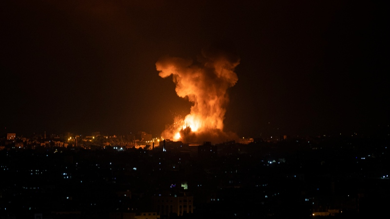 An explosion caused by Israeli airstrikes on the Gaza Strip is seen early Tuesday, May 11, 2021. (AP Photo/Khalil Hamra)