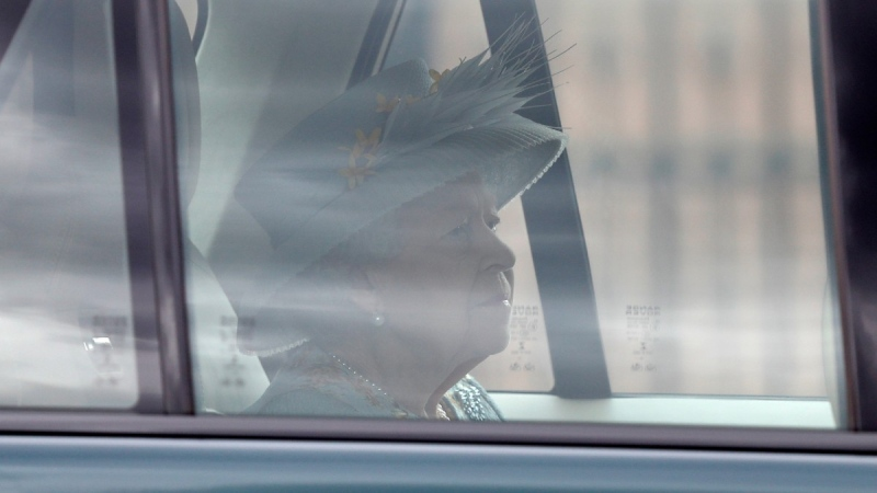 Queen Elizabeth II leaves Buckingham Palace by car to attend the State Opening of Parliament at the Palace of Westminster in London, on May 11, 2021. (Alastair Grant / AP)