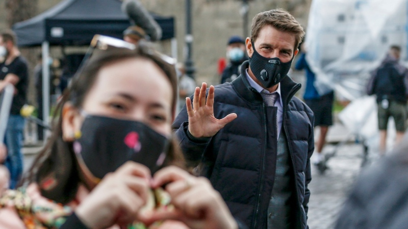 Tom Cruise waves to fans during a break in the shooting of the film Mission Impossible 7, in Rome, on Oct. 12, 2020. (Cecilia Fabiano / LaPresse via AP)