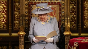 Queen Elizabeth II delivers a speech in the House of Lords during the State Opening of Parliament at the Palace of Westminster in London, Tuesday May 11, 2021. (Chris Jackson/Pool via AP)