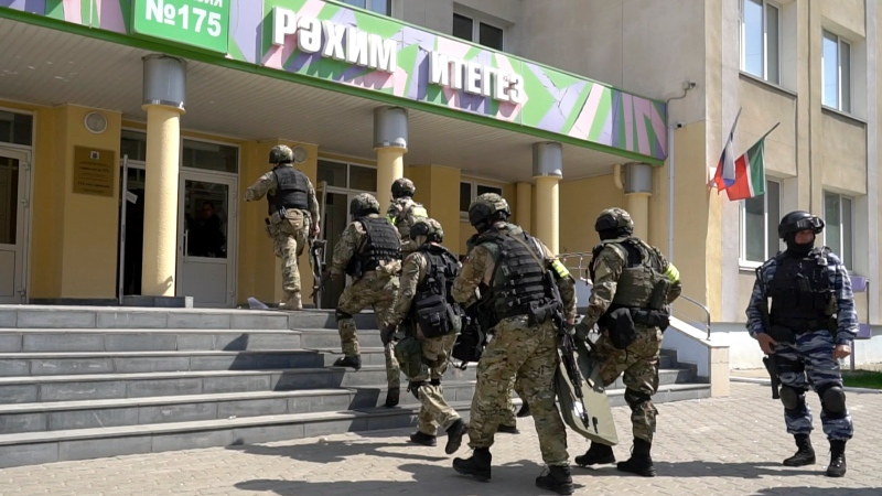 In this photo released by Tatarstan Presidential Press Service, Russian police special unit near the scene at a school after a shooting in Kazan, Russia, Tuesday, May 11, 2021. (The Investigative Committee of the Russian Federation via AP)