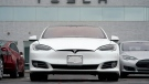 This Sunday, May 9, 2021 file photo shows vehicles at a Tesla location in Littleton, Colo. According to the U.S. National Transportation Safety Board, home security camera footage shows that the owner of a Tesla got into the driver's seat of the car shortly before a deadly crash in suburban Houston. (AP Photo/David Zalubowski)