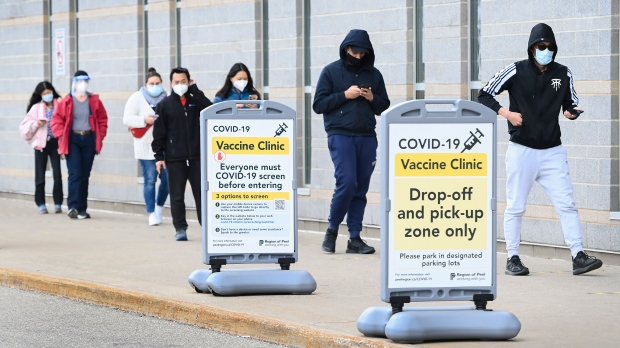 People line up at a mass vaccination centre during the COVID-19 pandemic in Mississauga, Ont., on Monday, May 10, 2021. THE CANADIAN PRESS/Nathan Denette