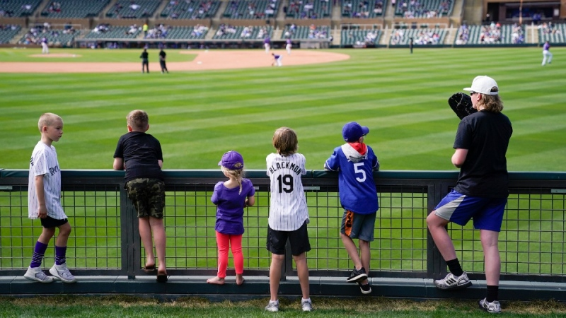 Watching a spring training baseball game in Scottdale, Ariz., on  March 15, 2021. (Ashley Landis / AP)