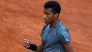Felix Auger-Aliassime celebrates after beating Diego Schwartzman at the Italian Open tennis tournament in Rome, on May 11, 2021. (Alessandra Tarantino / AP)