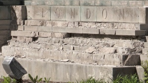 The crumbling base of the 'People and the City' monument on Wellington Street, just north of Queens Avenue, in London, Ont. is seen on Tuesday, May 11, 2021. (Sean Irvine / CTV News)