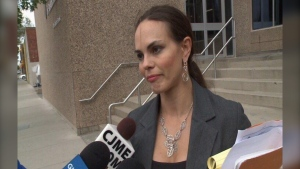 Sharon Fox speaks to reporters in front of the Provincial Courthouse in Regina, in June 2017.