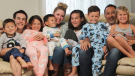 After their parents died in a crash, seven siblings have been adopted by the same couple in California.