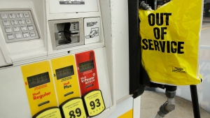 A gasoline station that ran out of gas for sale displays an out of service sign on the pump on Tuesday, May 11, 2021, in Atlanta. Gasoline futures are ticking higher following a cyberextortion attempt on the Colonial Pipeline, a vital U.S. pipeline that carries fuel from the Gulf Coast to the Northeast. (AP Photo/Ben Margot)