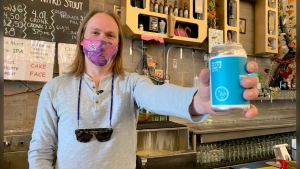 Cold Garden Beverage Company in Calgary's Ramsay neighbourhood is trading proof of a shot for a cold one, called 'Cans for Community Immunity.'