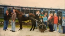 Family and friends celebrating one of Sammy's victories in the winner's circle at the Truro Raceway. (Photo: Jayson Baxter)