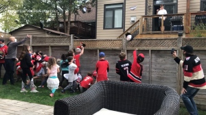 Neighbourhood children celebrate Ottawa Senators rookie Tim Stützle for his first ever NHL hat-trick. Ottawa, On. May 10, 2020. (Photo courtesy of Andrew Morrisey)