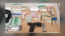 Police showcase guns and drugs that were allegedly seized in a May 6, 2021, arrest.