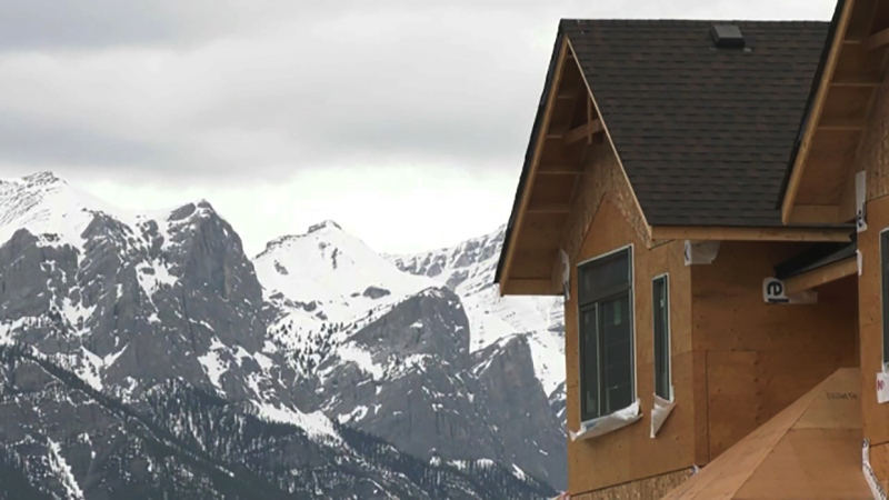 A decision on whether to proceed with a controversial real estate development near Canmore was delayed two weeks Tuesday