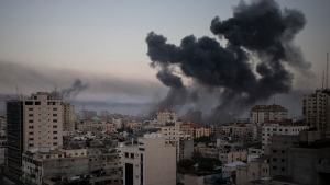 Smoke rises after Israeli airstrikes on Gaza City, Wednesday, May 12, 2021. (AP Photo/Khalil Hamra)
