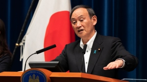Japanese Prime Minister Yoshihide Suga responds to a reporter's question after he spoke at a news conference in Tokyo on Friday, May 7, 2021. (AP Photo/Hiro Komae)