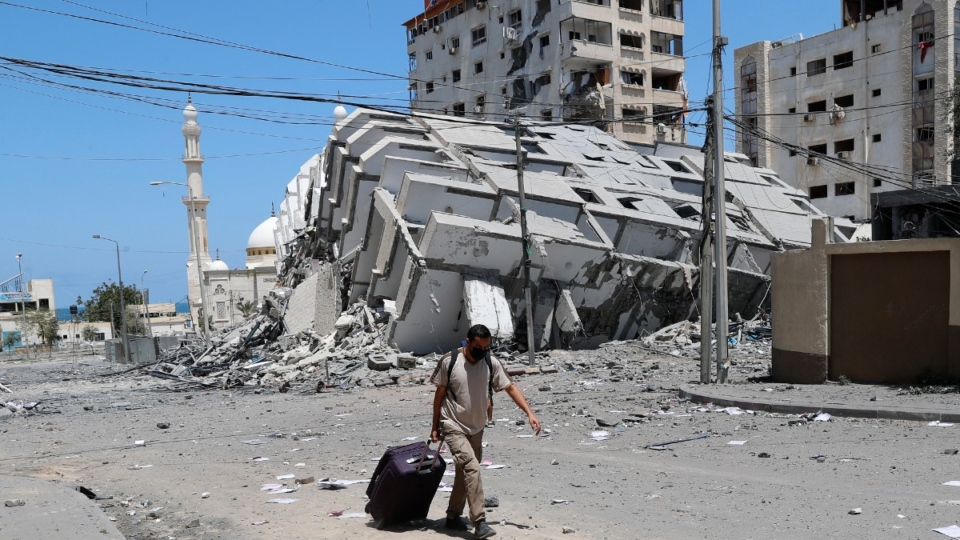 A man pulling his luggage in Gaza City