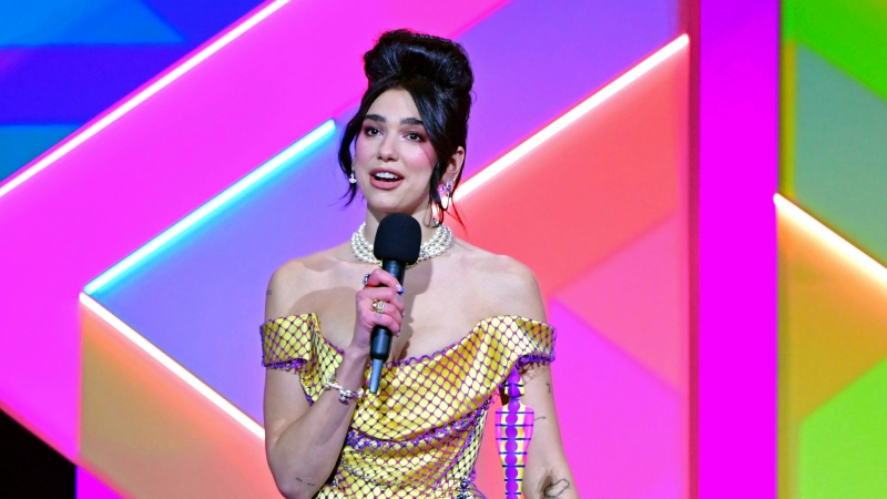 Dua Lipa accepts the award for Female Solo Artist during the Brit Awards 2021 at the O2 Arena, London, Tuesday, May 11, 2021. (Ian West/PA via AP)