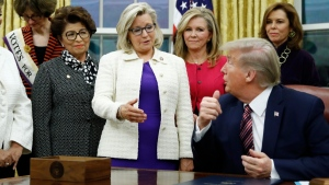 Rep. Liz Cheney, R-Wyo., centre, speaks with U.S. President Donald Trump in the Oval Office of the White House in Washington, on Nov. 25, 2019. (Patrick Semansky / AP)