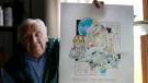 "Artist Robert Seaman holds up the 365th daily doodle sketch in his room at an assisted living facility Monday, May 10, 2021, in Westmoreland, N.H. Seaman, who moved into the facility weeks before the COVID-19 pandemic shutdown his outside world in 2020, recently completed his 365th daily sketch, or what he calls his ""COVID Doodles"", since being isolated due to the virus outbreak. (AP Photo/Charles Krupa)"