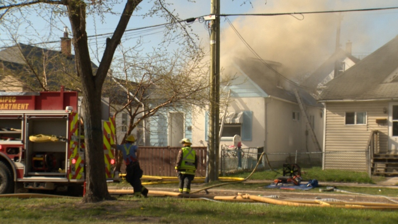 Firefighters respond to a fire at a home on Burrows Avenue on May 12, 2021 (CTV News Photo Owen Swinn)