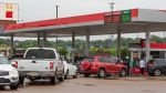 Drivers line up to fill their tanks with gas at the Kroger station on I-55N frontage Road in Jackson, Miss., Tuesday, May 11, 2021, after a ransomware attack Friday, May 7, 2021, shutdown the Colonial Pipeline, a critical artery for gasoline in the southeastern United States. (Barbara Gauntt/The Clarion-Ledger via AP)