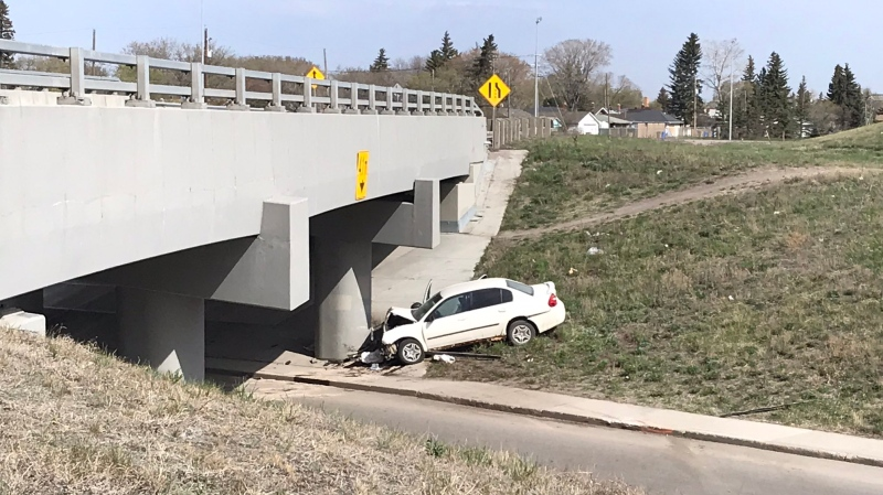 Police investigated a single vehicle crash near Ring Road, on May 12, 2021. (Jaden Lee-Lincoln/CTV News)
