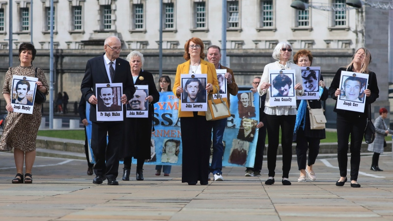Family members arrive for the inquest into the Ballymurphy shooting, in Belfast, Northern Ireland, Tuesday May 11, 2021. (AP Photo/Peter Morrison)