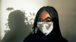 Stock image of a woman with a medical mask (RF._.Studio, Pexels)
