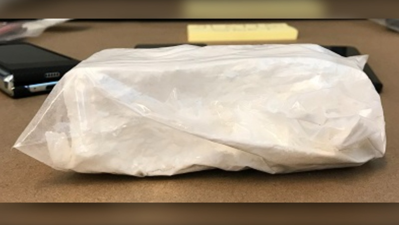 A partial brick of suspected cocaine has been seized by the Surrey Gang Enforcement Team as part of ongoing targeted gang enforcement in the city.