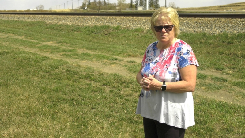 Bev Leung stands behind her home in Uplands. (Taylor Rattray / CTV News Regina)