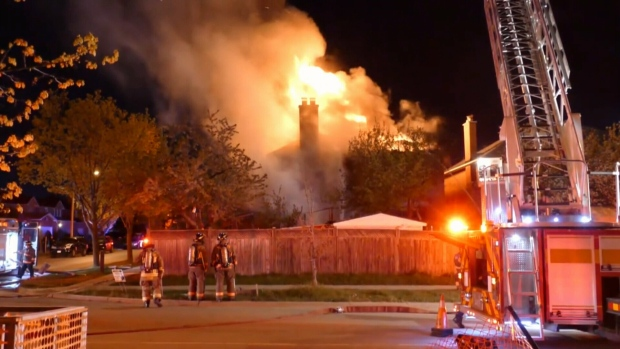 Emergency crews attend the scene of a fire in Rexdale on May 12, 2021.