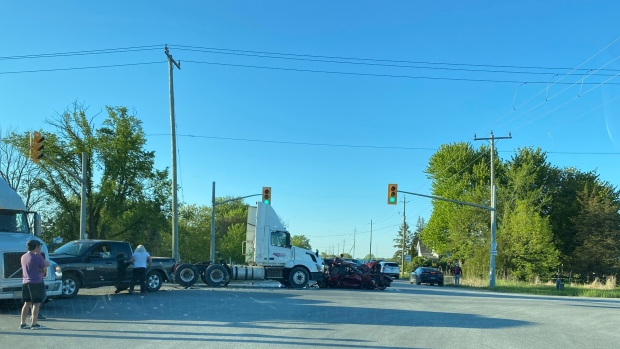 Police, paramedics and fire crews were on scene of a collision on County Road 42 in Belle River, Ont. on Wednesday, May 12, 2021. (Dan Cress/CTV Windsor)
