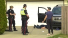 Two men describe a collision sequence to police after a woman was taken to hospital by paramedics. She later died of her injuries. May 12, 2021. (Sean Amato/CTV News Edmonton)