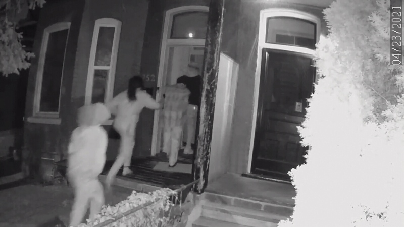 People are seen in this security video footage attending a short-term rental.