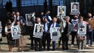 """The Ballymurphy families react after the inquest in Belfast, Northern Ireland, Tuesday May 11, 2021. Family members applauded as coroner Siobhan Keeganv in Northern Ireland ruled that 10 people killed during a military operation in west Belfast 50 years ago were """"entirely innocent'' and soldiers were responsible for nine of the deaths. (AP Photo/Peter Morrison)"""