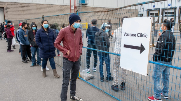 People line up for the COVID-19 vaccination clinic at the Ontario Food Terminal in Toronto on Tuesday May 11, 2021. THE CANADIAN PRESS/Frank Gunn