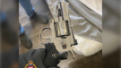 The Victoria Police Department says patrol officers issued a search warrant at a suite and found a revolver before locating a suspect who tried to escape on a bicycle. (VicPD)