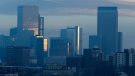 FILE - In this Thursday, Feb. 28, 2019, file photograph, pollution obscures the skyline of downtown as the sun rises over Denver, Col,. (AP Photo/David Zalubowski, File)