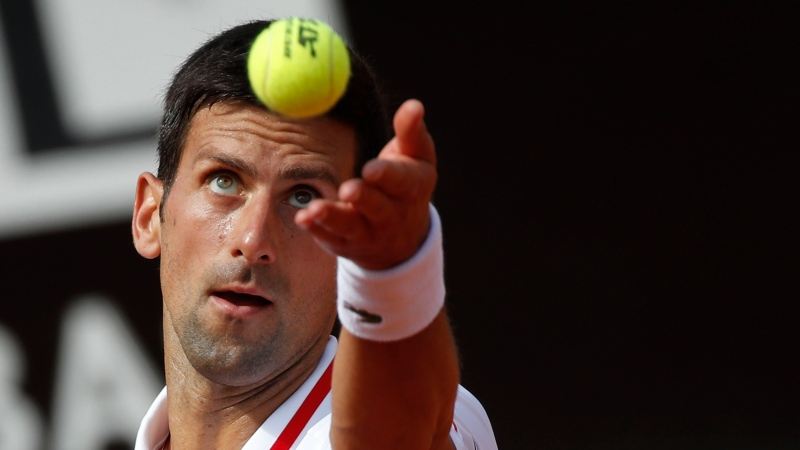 Novak Djokovic serves the ball to Alejandro Davidovich Fokina during their 3rd round match at the Italian Open tennis tournament, in Rome, Thursday, May 13, 2021. (AP Photo/Alessandra Tarantino)