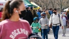 Shoppers at the Union Square farmers market wear masks to protect against the coronavirus, Friday, March 26, 2021, in New York.  (AP Photo/Mary Altaffer)