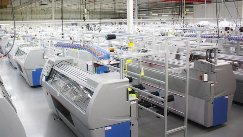 Myant currently manufacturers garments for Skiin using state of the art 3D robotic knitting machines, shown in a handout photo, in its nearly 7,500-square-metre facility in Etobicoke, Ont., and plans to open new production facilities as demand scales.  HO-Myant Inc. / THE CANADIAN PRESS