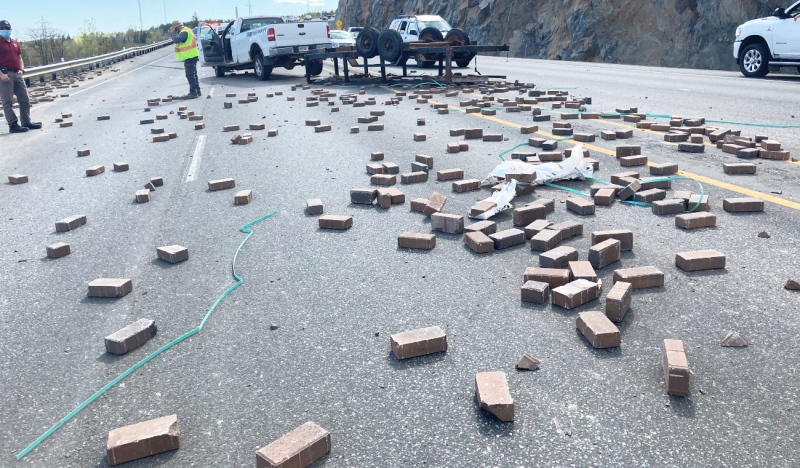 A trailer carrying bricks lost its load Thursday afternoon along the Lasalle Extension. (Alana Everson/CTV News)