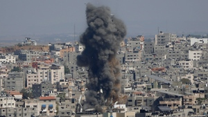 Smoke rises following Israeli airstrikes on a building in Gaza City, Thursday, May 13, 2021. Gaza residents are bracing for more devastation as militants fire one barrage of rockets after another and Israel carries out waves of airstrikes. (AP Photo/Hatem Moussa)