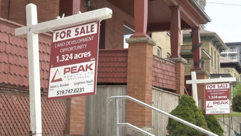 A for sale sign in front of a rental property in Kitchener