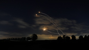 Israeli Iron Dome air defence system launches to intercept rockets fired from Gaza Strip, near Sderot, Israel, Thursday, May 13, 2021. (AP Photo/Ariel Schalit)