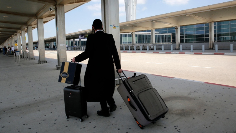 Global airlines are cancelling flights to Israel as clashes between the country's military and Palestinian militants in Gaza intensify. (GIL COHEN-MAGEN/AFP/Getty Images)