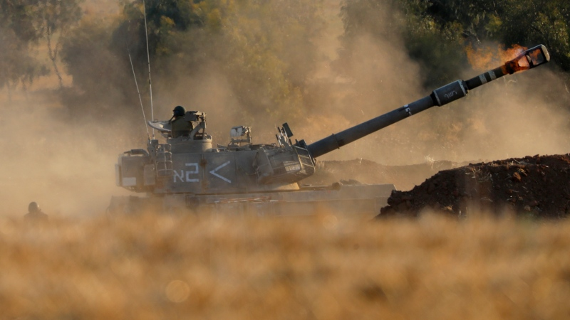 An Israeli artillery unit fires toward targets in Gaza Strip, at the Israeli Gaza border, Thursday, May 13, 2021. (AP Photo/Ariel Schalit)
